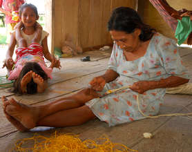Angelina's mother Ernestina weaving a belt