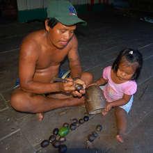 Bora artisan carving tutuma ornament with daughter