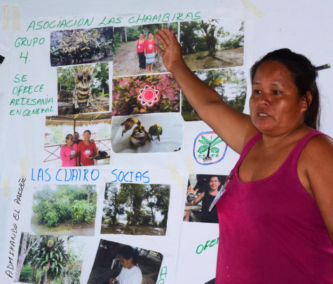 Zoraida presenting group poster to artisan leaders