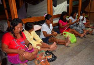 Artisans twining chambira fiber at CACE workshop