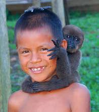 Bora boy with baby monkey on his head
