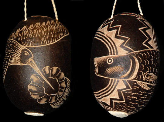 Humingbird and paiche fish tutuma ornaments.