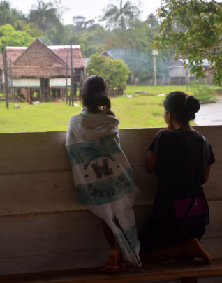 Mother and daughter looking at rain at Nuevo Peru