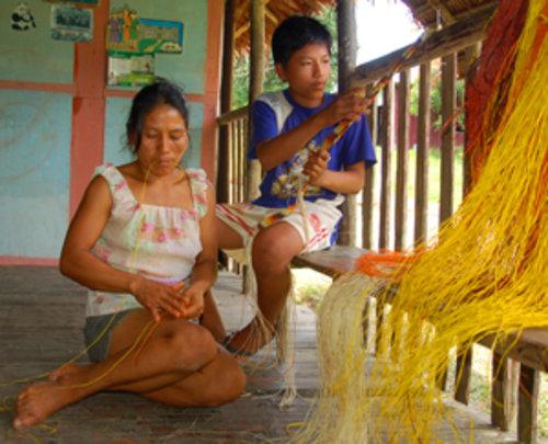 Bora native artisan and son weaving chambira belts
