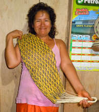 Yagua woman artisan with palm fiber doll hammock