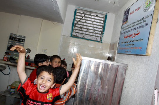 Children drinking water from Maia unit in Gaza