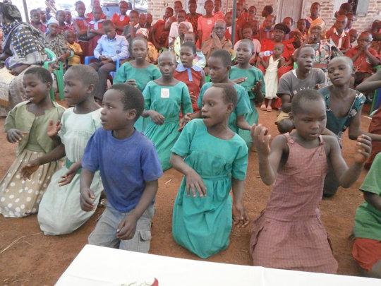 Children performing during school visit in August