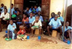 Children eating posho and beans
