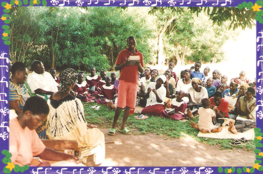 Children receiving scholastic materials