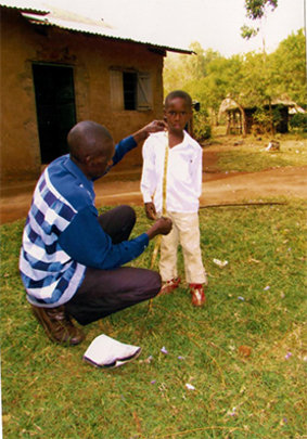 Boy being measured for a new uniform