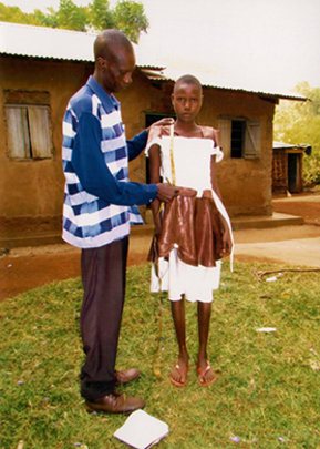 Girl measured for new school uniform
