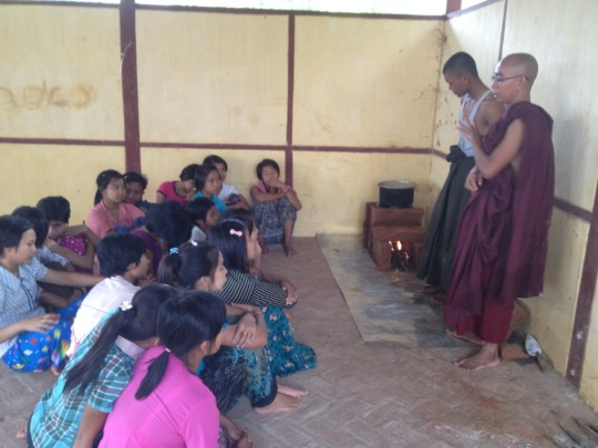 A monk explains the stove to his students