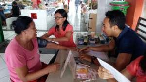 YRS Staff attend to a client at Pasar Intaran MC