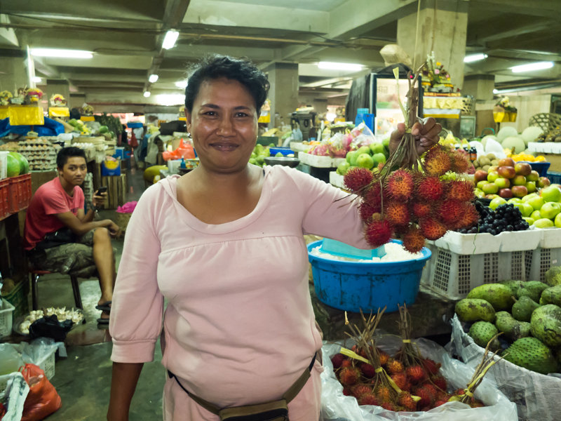 A vendor and YRS client at the traditional market