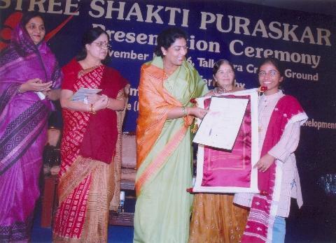 Dr. Sunitha awarded by Mrs. Chowdhury