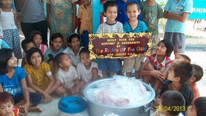 Agape's children welcoming the Rabbit Meat