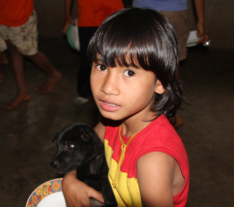 Young girl with puppy.