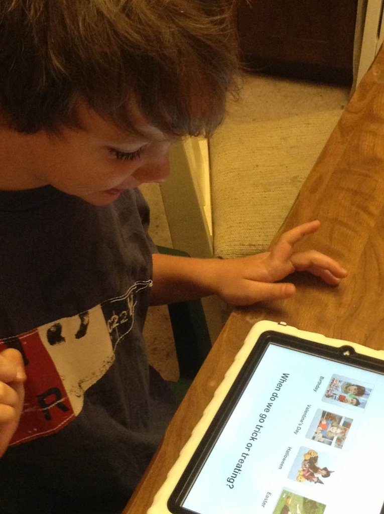 Max loves using his iPad to learn!