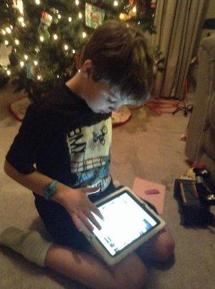 Max loves his iPad!!