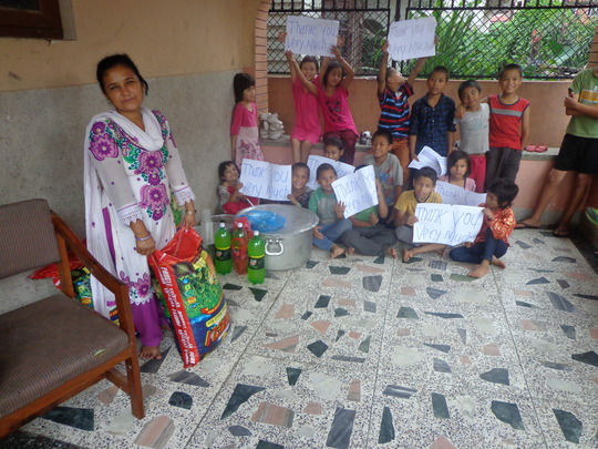 Sarita is happy to receive food materials from CDC
