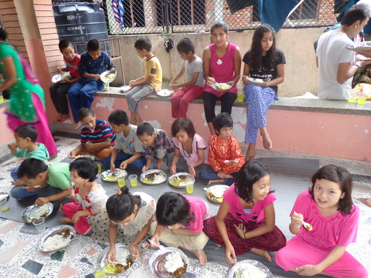 Kids enjoying feast organised by CDC Nepal