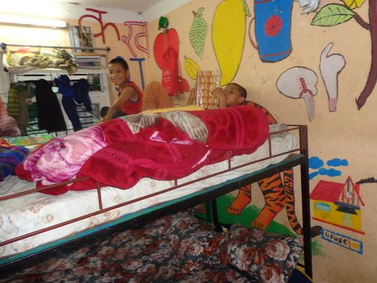 Kids having rest in bed.