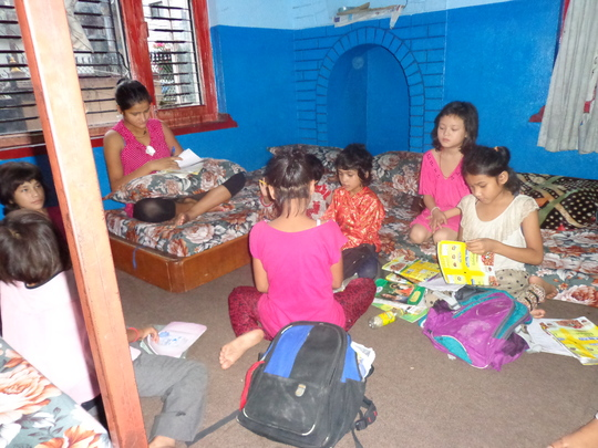 Kids reading in the room
