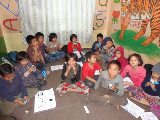 Kids having  sweets on Women day