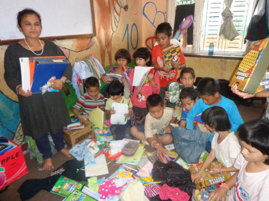 The kids receiving  stationery from  CDC Nepal