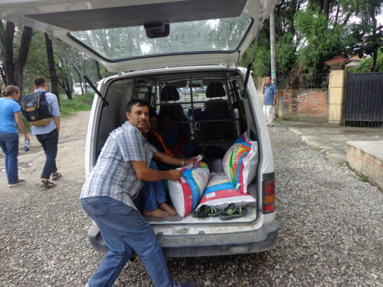 CDC chairman unloading food materials for the kids