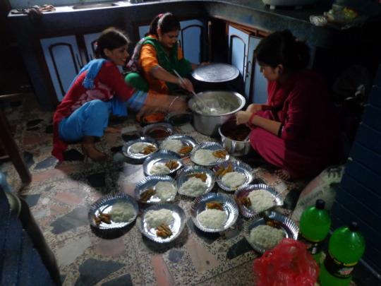 CDC Nepal committee members serving  food.