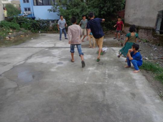 Kids paying football
