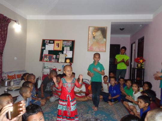 The kids enjoy dancing and singing