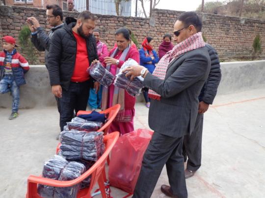 CDC Chairman checking school dress to distribute