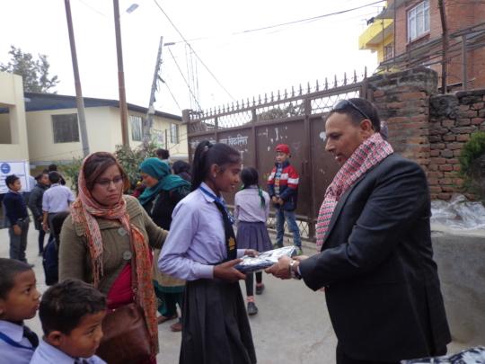 A girl receiving school dress