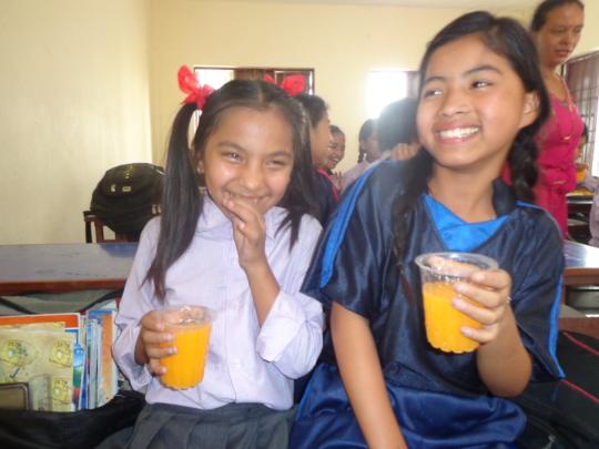 Some girls enjoy drinking soft drinks.