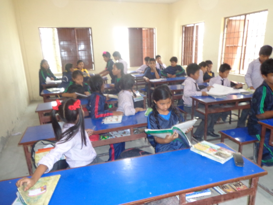 The kids studying in the classroom