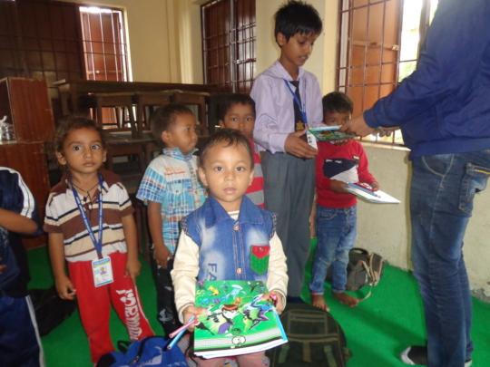 CDC Nepal Distributing stationery