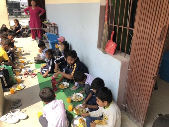 Providing food to orphanage kids