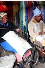 Ladies preparing yarn from mohair