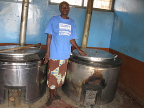 One of the cooks and the cooking vessels