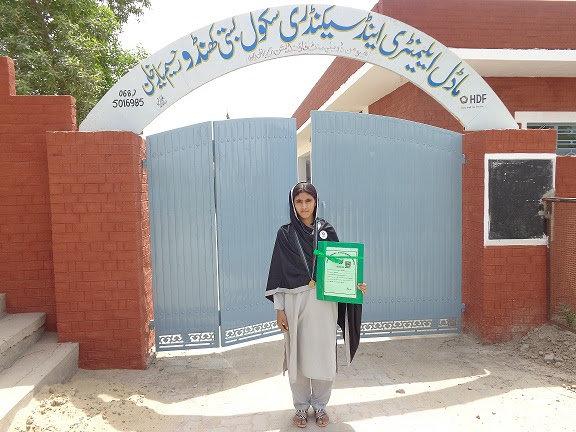 Aqsa in front of her school