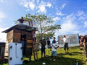 Noah Haas installing solar panels