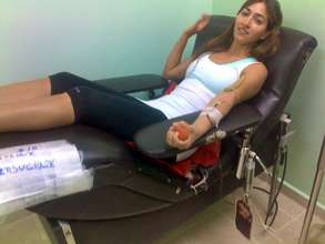 Volunteer donating blood for a patient