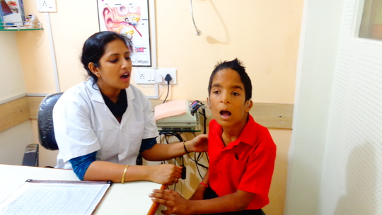 Sudhir getting speech therapy with hearing aids