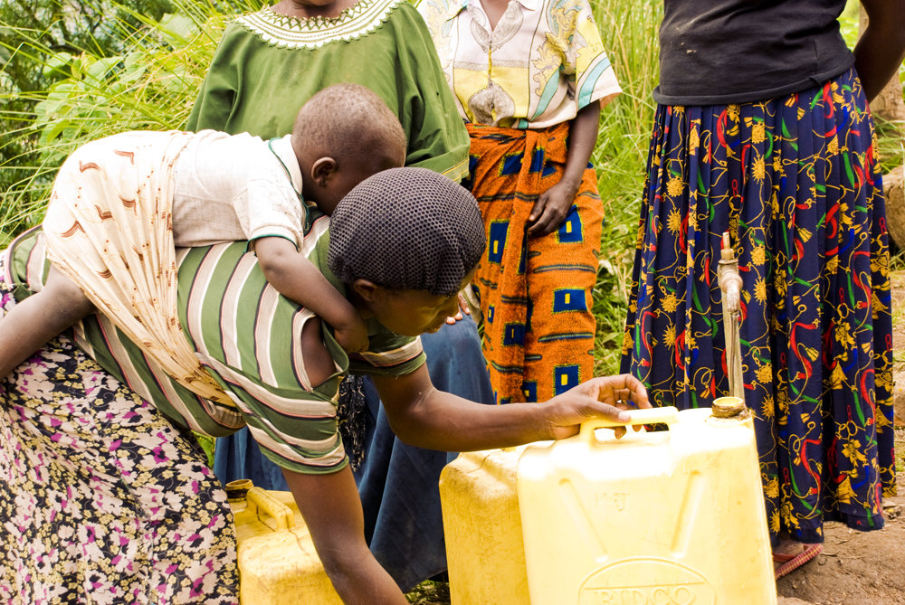 Gathering water at new RRHS gravity fed pump