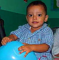 Allan playing w/ a balloon at the clubfoot clinic