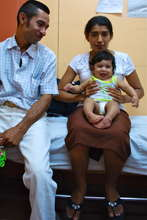 A family waits for treatment to begin
