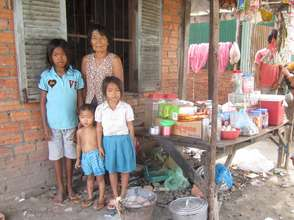 Cambodian woman and grandchildren in grocery shop