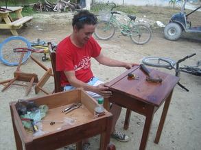Danny repairing school furniture